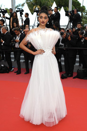 Neelam Gill looked fancy in a strapless white gown with a feathered, fan-shaped bodice at the Cannes Film Festival screening of 'The Wild Pear Tree.'