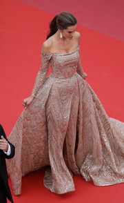 Alessandra Ambrosio cut a regal figure in an embellished gold off-the-shoulder gown by Zuhair Murad Couture at the Cannes Film Festival screening of 'The Wild Pear Tree.'