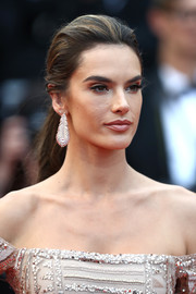 Alessandra Ambrosio accessorized with a pair of diamond feather earrings.