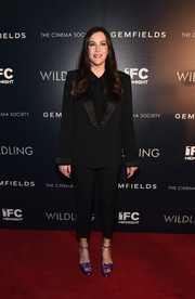 Liv Tyler injected a pop of color with a pair of purple satin platforms by Tabitha Simmons.