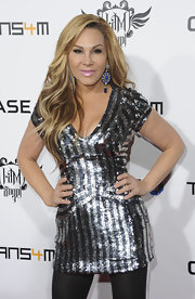 Adrienne Maloof looked like she just stepped out of the disco era with that glittery black and silver striped dress.