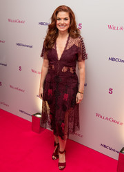 Debra Messing complemented her dress with a pair of burgundy ankle-cuff sandals.