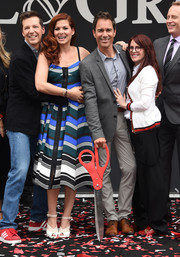 Debra Messing was summer-chic in a striped spaghetti-strap dress by Fendi at the 'Will & Grace' ribbon cutting ceremony.
