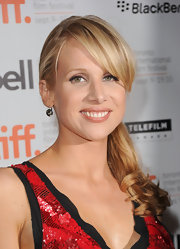 Lucy Punch kept it simple with a ponytail and side-swept bangs at the premiere of 'You Will Meet a Tall Dark Stranger.'