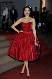Sonam Kapoor's red satin pumps and ultra-feminine dress looked perfect together.