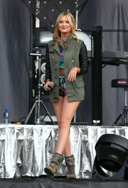 Laura Whitmore exuded cool-girl vibes in a olive green utility jacket with leather sleeves.