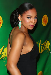 "The star of ""The Wiz"" Ashanti stepped out on the red carpet for the opening night looking very elegant she wore her hair in a sleek bun that was full of volume."
