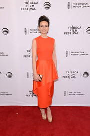 Carla Gugino caught eyes in a bright orange dress with oversized peplum detailing during the Tribeca Film Fest premiere of 'Wolves.'