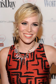 Singer Natasha Bedingfield paired her black-and-red geometric print dress with a crystal and gold statement necklace.