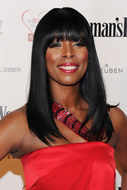 Tasha Smith went for a sleek and classic look with straight locks with blunt cut bangs.