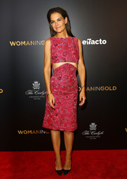 Katie Holmes looked youthful and trendy in a fuchsia brocade cutout dress by Zac Posen at the 'Woman in Gold' premiere.