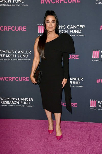 Kyle Richards added a pop of color with a pair of fuchsia pumps.
