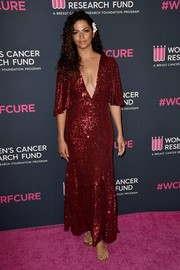 Camila Alves chose bedazzled flat sandals to finish off her look.
