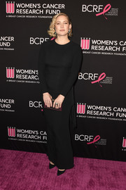 Kate Hudson styled her dress with a black and purple box clutch by Judith Leiber.