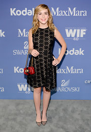 Kiernan Shipka looked sleek and sophisticated in this black star-patterned LBD.