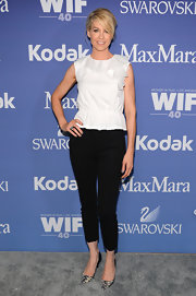 Jenna stuck to a simple white ruffled blouse and black capris for the Lucy + Crystal Awards.