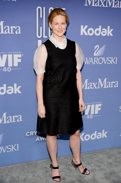 Laura Linney paired this classic black dress over a puffed-sleeve white button down for a cool pilgrim-inspired look.