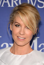 Jenna Elfman pulled back her blonde tresses into a stylish updo that let her side-swept bangs fall effortlessly across her face.