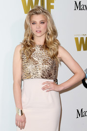 Natalie Dormer wore a gold cuff for added shimmer to her dress at the 2016 Crystal + Lucy Awards.