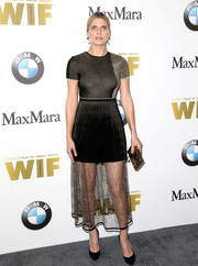 Lake Bell teamed her sexy-chic dress with a textured metallic clutch.