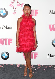 Logan Browning was a vision in a fuchsia ruffle halter dress by Armani at the 2017 Crystal + Lucy Awards.