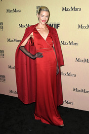 Jaime King layered a red silk coat over a matching gown for the 2019 Women in Film Gala.