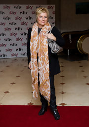Jennifer Saunders cozied up in a tan-and-white scarf that almost reached the floor.