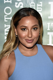 Adrienne Bailon topped off her look with a center-parted hairstyle when she attended Women's Health's Party Under the Stars.