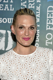 Molly Sims brushed her hair back into a casual bun for Women's Health's Party Under the Stars.