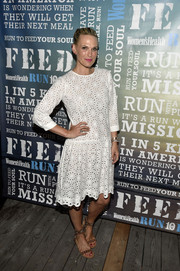 Molly Sims was cute and feminine in a little white eyelet dress during Women's Health's Party Under the Stars.