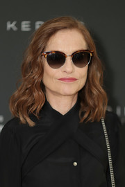 Isabelle Huppert sported a shoulder-length wavy 'do at the Women in Motion event.