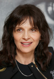 Juliette Binoche sported casual waves with wispy bangs at the Women in Motion Talks.