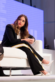 Jessica Alba teamed a pair of House of Harlow 1960 side-striped slacks with a black blazer for the Women Rule: The L.A. Summit.