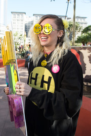 Miley Cyrus looked wacky in her yellow Happy Hippie Foundation sunglasses at the women's march in Los Angeles.