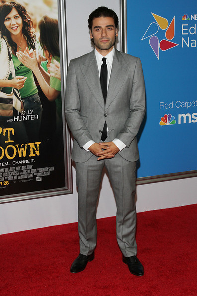 At the 'Won't Back Down' New York Premiere, Oscar Isaac wore a light gray blazer over a white button-up shirt and black tie.