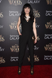 Celina Carvajal looked trendy in a black cowl-neck jumpsuit during the premiere of 'Into the Woods.'