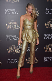 Jackie Miranne shone on the 'Into the Woods' red carpet in a strapless gold peplum top.