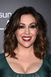 Alyssa Milano wore plenty of metallic gold eyeshadow for a bold and sexy beauty look.