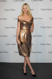 Lara Stone paired her ankle strap pumps with a metallic off-the-shoulder dress.