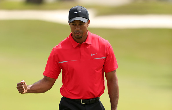 Tiger Woods sported his signature red hue with this red polo.
