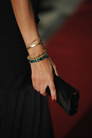 Afef Jnifen wore beautiful gold and green beaded bracelets at the World Music Awards 2010.