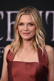 Michelle Pfeiffer wore her hair in a gently wavy style at the world premiere of 'Maleficent: Mistress of Evil.'