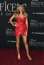 Heidi Klum complemented her frock with grommeted red sandals by  Giuseppe Zanotti.