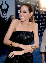 Angelina Jolie teamed black nail polish with a goth-glam dress for a totally edgy look.