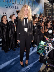 Juno Temple opted for a menswear-inspired look with this black Dolce & Gabbana pantsuit when she attended the premiere of 'Maleficent.'