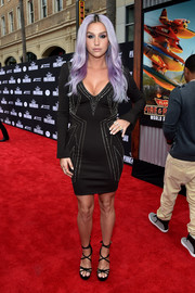 Kesha put her ample cleavage on display in a low-cut, studded LBD during the premiere of 'Planes: Fire & Rescue.'