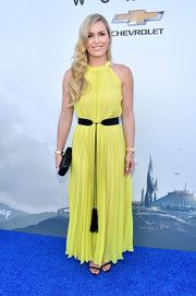 Lindsey Vonn brought a bright pop to the world premiere of 'Tomorrowland' with this pleated yellow maxi dress.