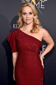 Reese Witherspoon paired a diamond bracelet by Cartier with a red one-sleeve dress for the premiere of 'A Wrinkle in Time.'