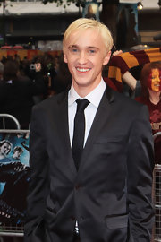 Harry Potter star Tom Felton wears his blonde locks parted to the side.