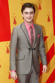 Daniel showed off his dapper side in a paisley print tie, which he paired with a salmon shirt and matching pocket scarf.